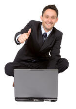 business man on laptop with a positive attitude over a white background
